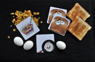 Pallabi Das - Breakfast Table Coasters ( She designed the characters on photoshop and printed them on coasters )